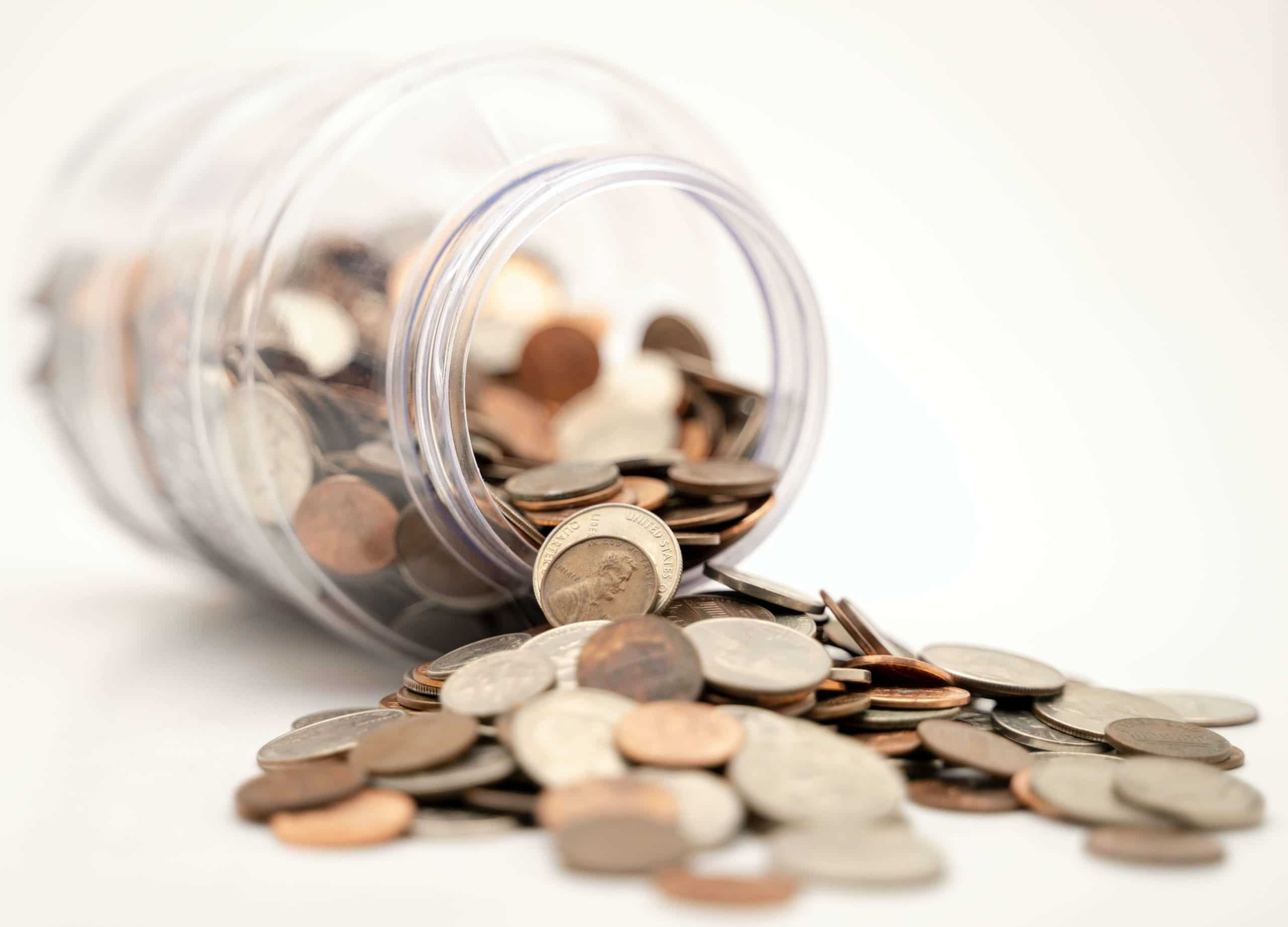 Glass filled with coins symbolizing Loan for your business in Germany